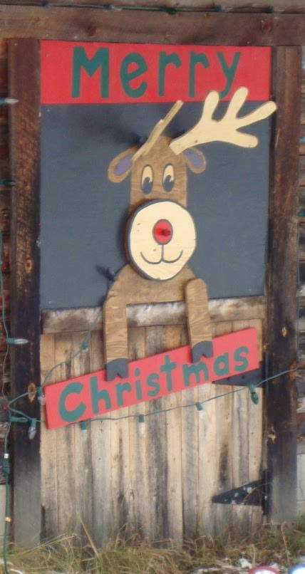 I wanted it to appear as if Rudolph was inside the barn looking out