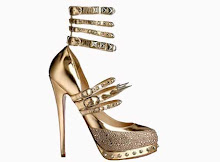 Christian Louboutin Spiked Gold Heels [Credit: shoewawa.com]