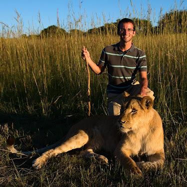 Posing with a lioness, Antelope Park, near Gweru, Zimbabwe