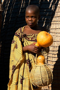 Girl holding gourds in a village in Swaziland © Matt Prater