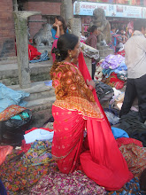 Woman in the midst of selling her fabrics...literally
