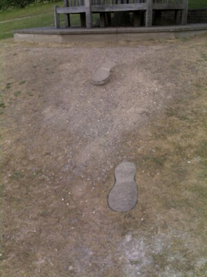 Giant footprints leading to Roald Dahl's grave