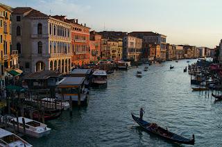 A Gondola glides along the Grand Canal
