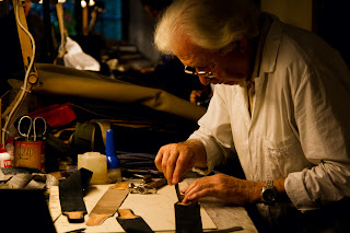 A Leather craftsman working on a strap for a bag - Firenze, Italy