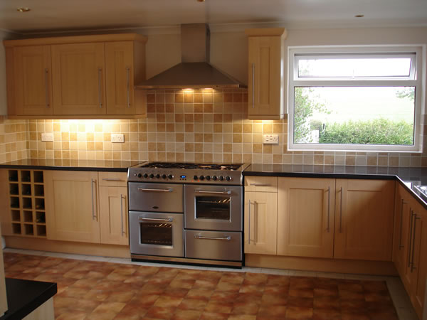 Kitchen Wall Tiles The multi shaded wall tiles pull this large fitted kitchen with central