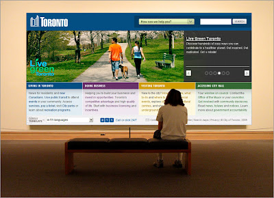 person standing in front of huge mural of toronto.ca webpage