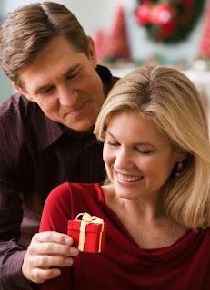 man giving his girlfriend a present
