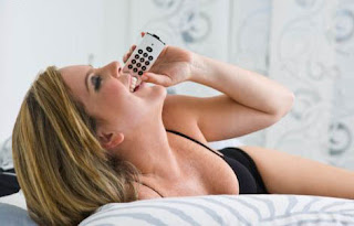 woman in bed talking to her boyfriend on the phone