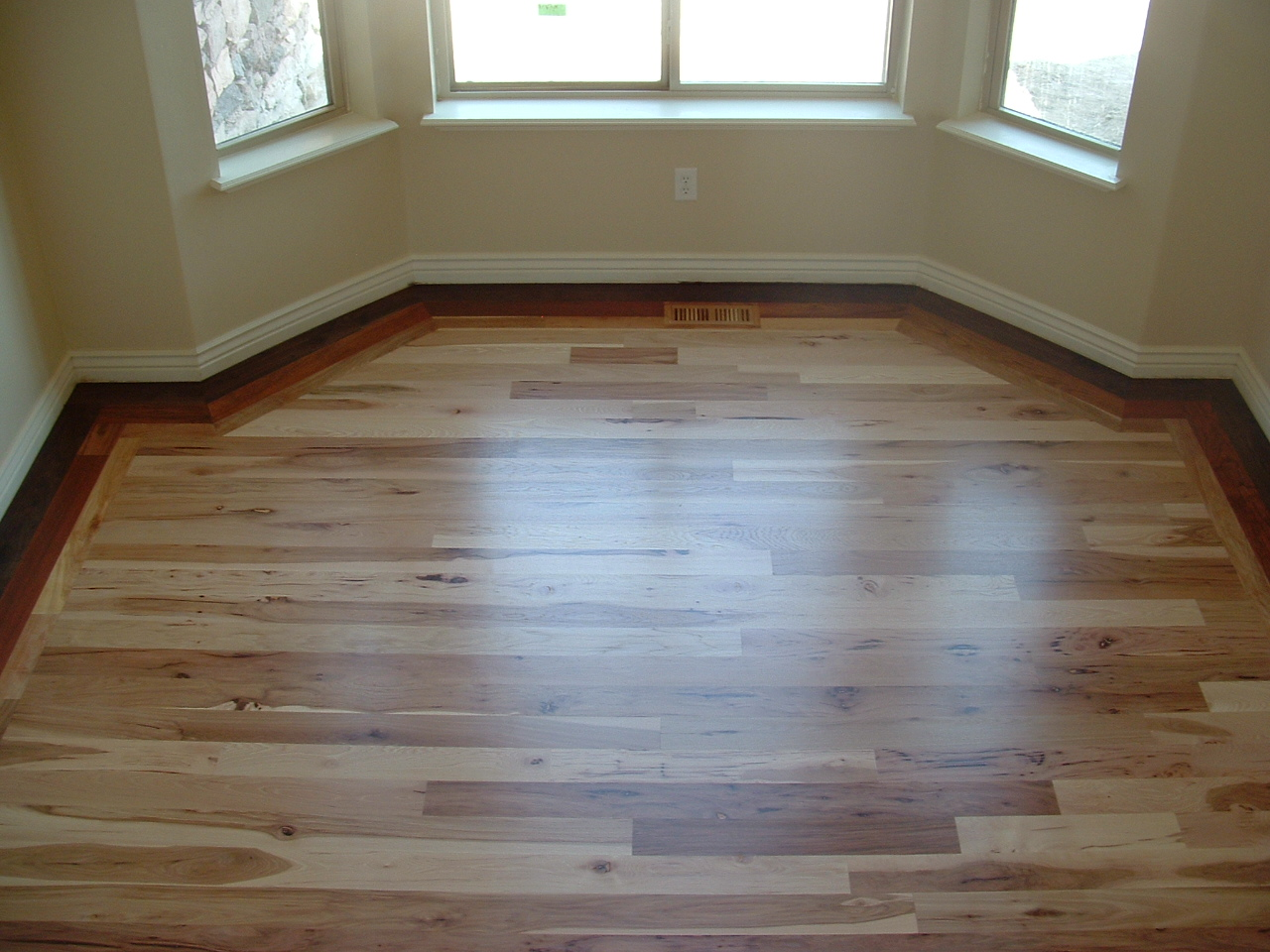 Wade homes custom hardwood flooring hickory with a for Custom hardwood flooring