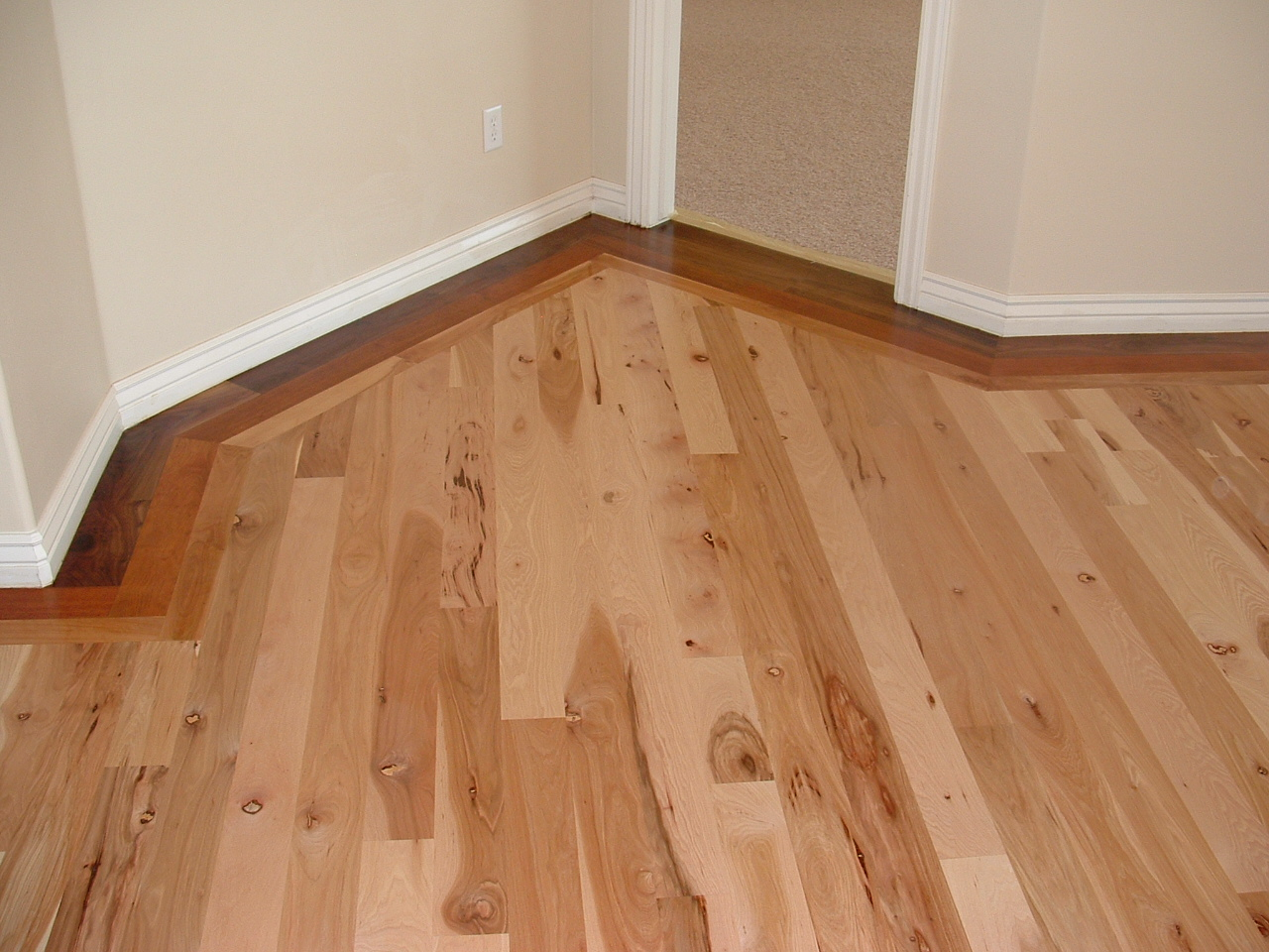 Wade homes custom hardwood flooring hickory with a for Homes with hardwood floors