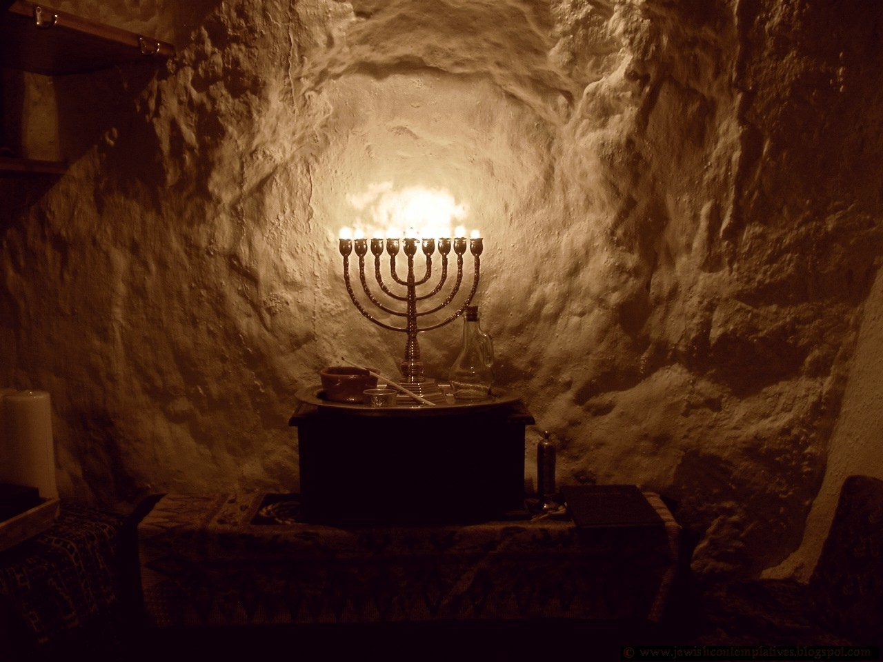 Jewish Contemplatives Lighting A Menorah With One Jar Of