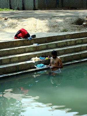 pandit pilgrim in river at Kheer bhawani kashmir