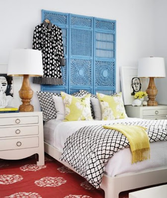 bedroom with turquoise rattan headboard