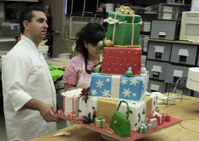 Buddy Valastro Renee Faris Cake Boss Colorful Characters & Christmas Costumes holiday party cake shoe makeup jewelry screencaps images pearls pictures photos screengrabs captures