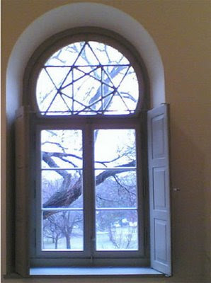 six-pointed star on an arched window