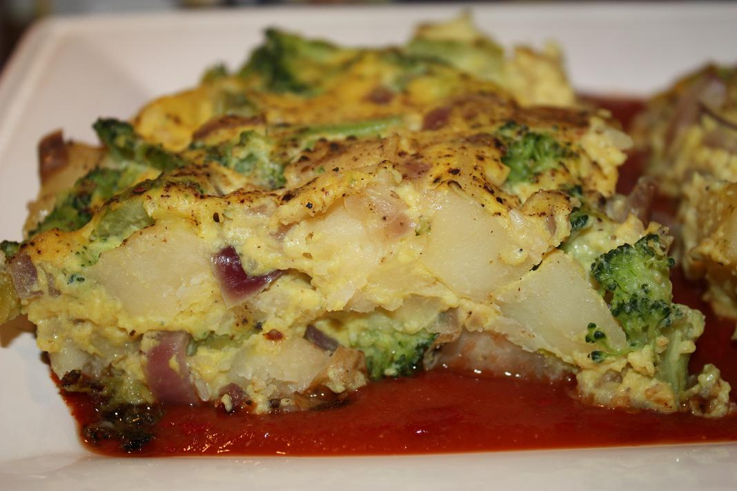 ... : Broccoli, Potato, and Onion Frittata on a bed of Tomato Sauce