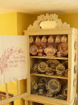 transferware dishes in a china cabinet