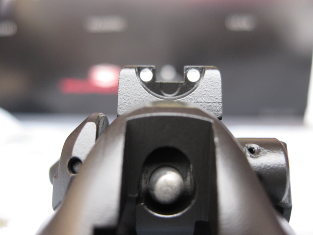 Close up of 2 white dots installed on Beretta Sight
