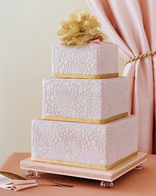 Bands of gold anchor the beautiful tiered blush pink cake with embossed
