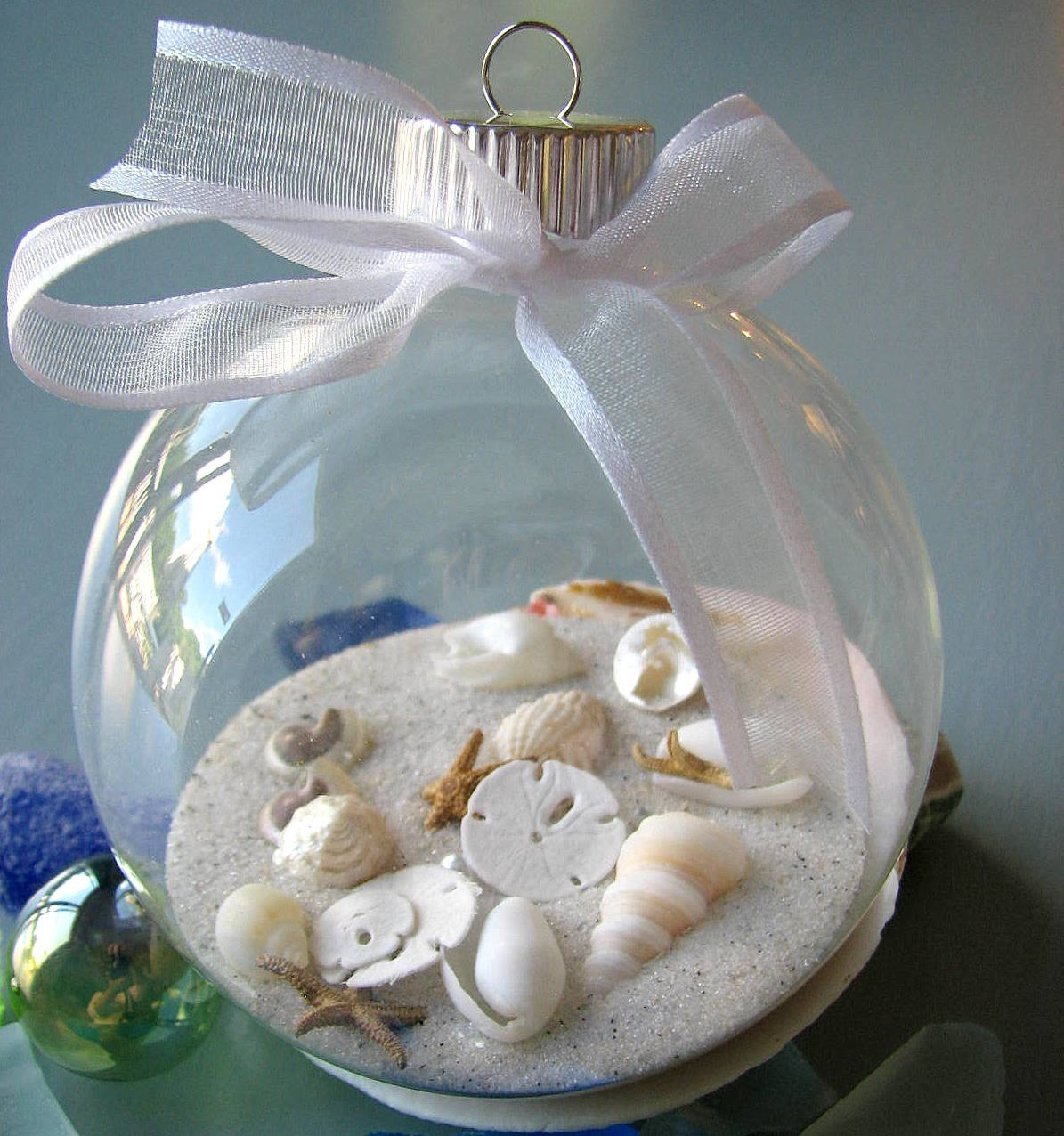 Sea shells sand in vases on pinterest seashells sea for Shells decorations home