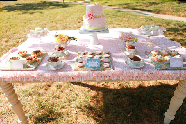 party food buffet with pink tablecloth