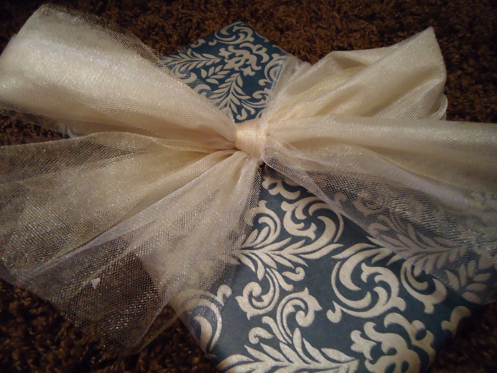 I make these poof bows for so many gifts! They're so simple and super cute! :) All you need is tulle and scissors! Here's how it works.