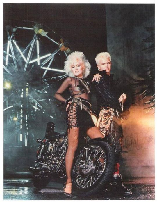 Judi Dozier and Billy Idol, relaxing at home with their Harley Davidson. Probably. Almost certainly.