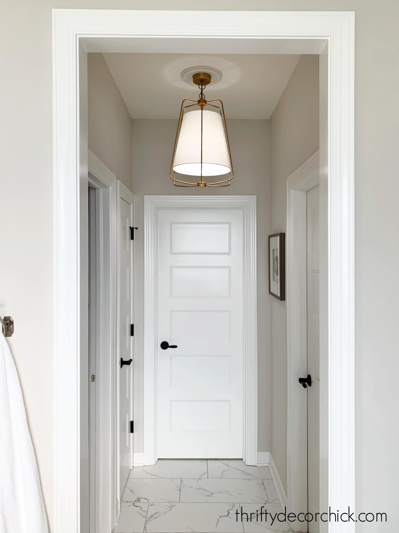 hanging brass light fixture in small hallway