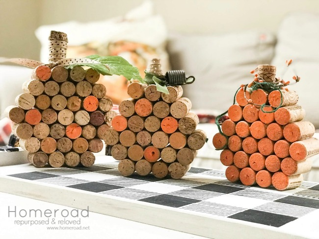 3 wine cork pumpkins on a buffalo check tray