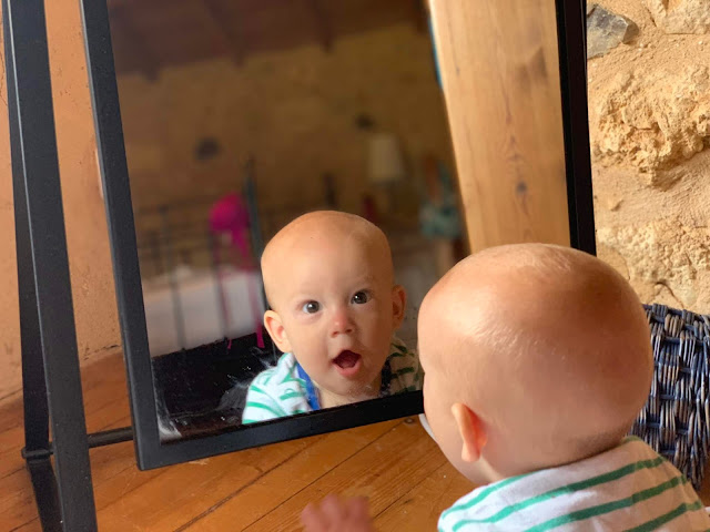 6 month old baby boy looking at his reflection
