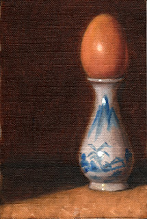 Oil painting of an egg resting in the top of a miniature blue and white porcelain vase.