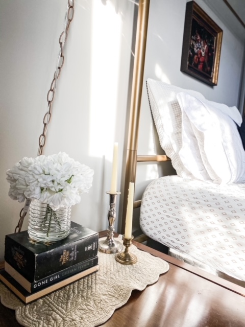 gold bed with white bedding