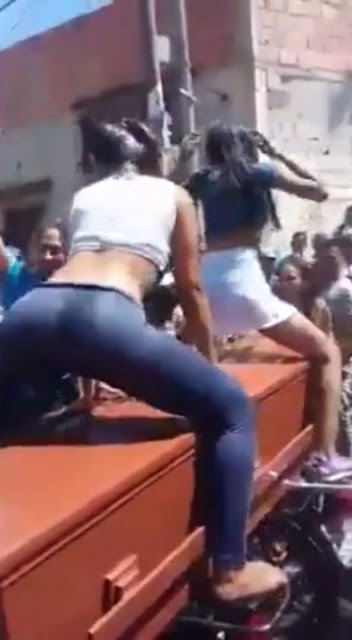 Two women filmed twerking over dead friend's coffin