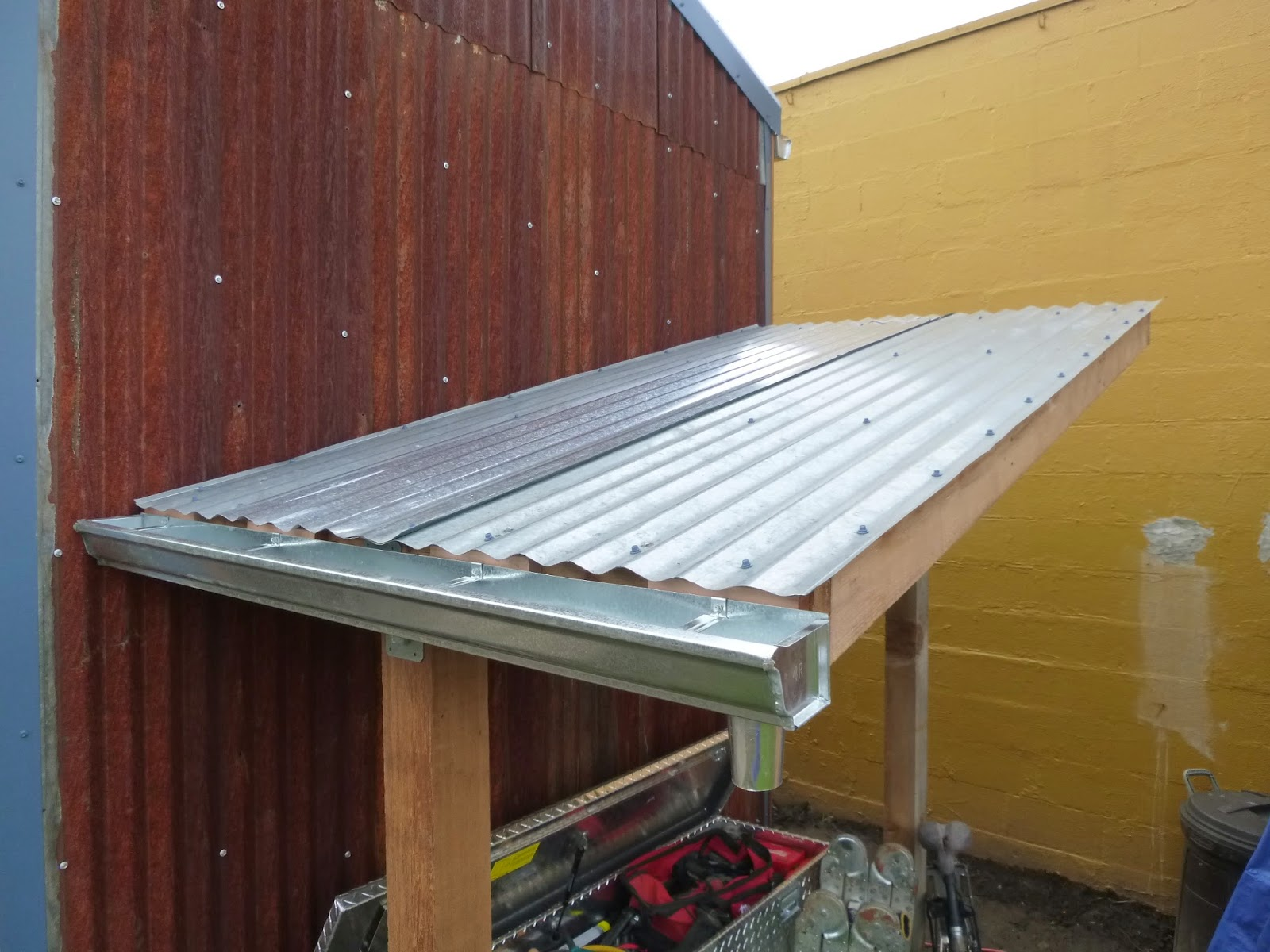 I Had A Leftover Section Of Gutter Which Was The Perfect Length For My Bike Tool Shed So Installed It On Low Side After T Corrugated Metal