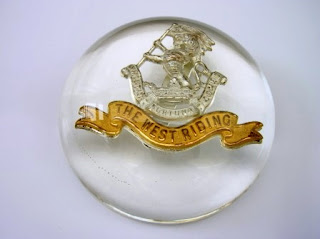 Paperweight for an army badge
