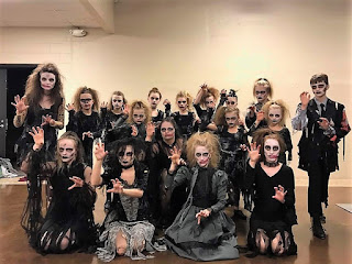 Group of teen gymnasts wearing zombie costumes