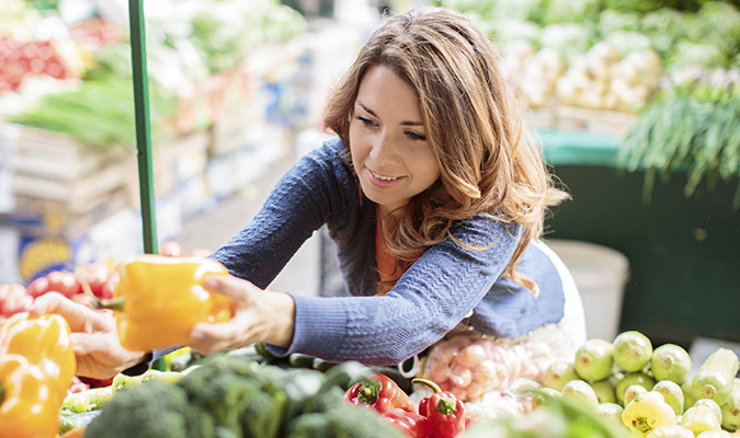 Woman buying healthy foods