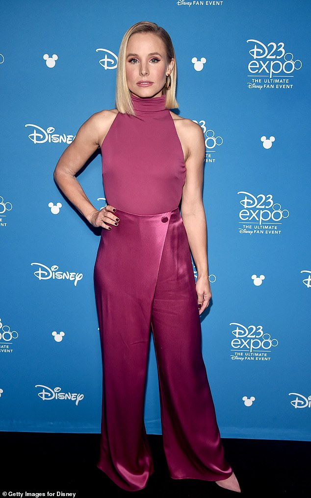 Kristen Bell looks chic in a magenta jumpsuit while promoting Encore! and Frozen 2 at the D23 Expo