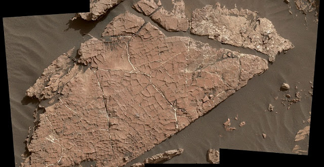 "The network of cracks in this Martian rock slab called ""Old Soaker"" may have formed from the drying of a mud layer more than 3 billion years ago. The view spans about 3 feet (90 centimeters) left-to-right and combines three images taken by the MAHLI camera on the arm of NASA's Curiosity Mars rover. Credit: NASA/JPL-Caltech/MSSS"