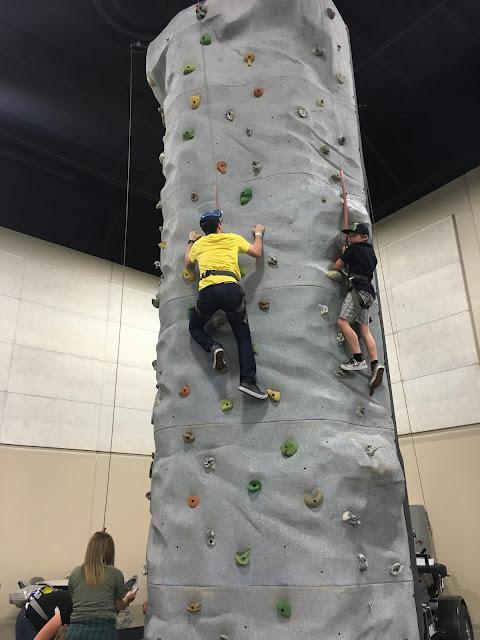 Ben climbing a rock wall