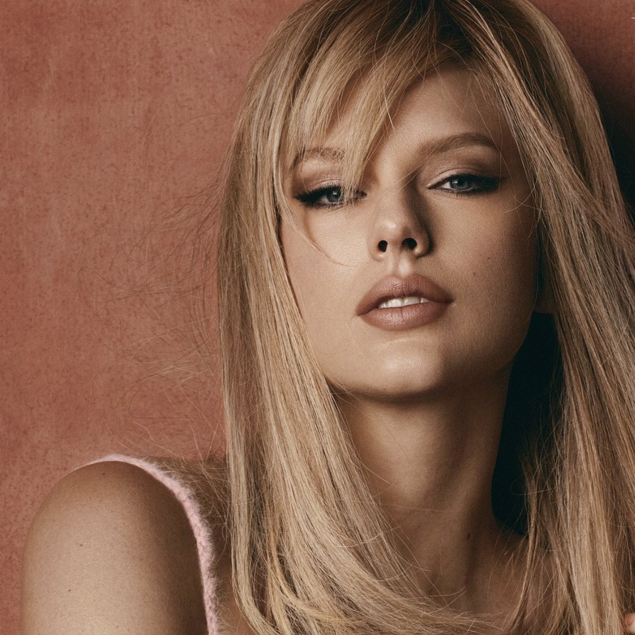 Singer Taylor Swift poses in pink J.W. Anderson dress