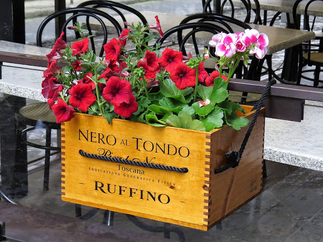 Wine crate used as a flower box outside a restaurant, via Orsanmichele, Florence