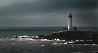 Lighthouse in storm Photo by Daniel Gregoire on Unsplash