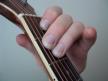 Bermain-Gitar
