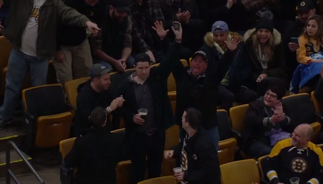 Bruins fan catches puck while holding beer