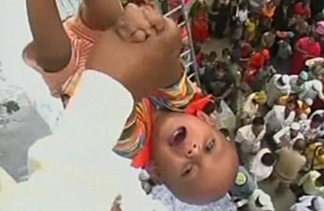 Tossing babies out of the roof for good luck-Maharashtra and Karnataka Tossing babies out of the roof for good luck-Maharashtra and Karnataka