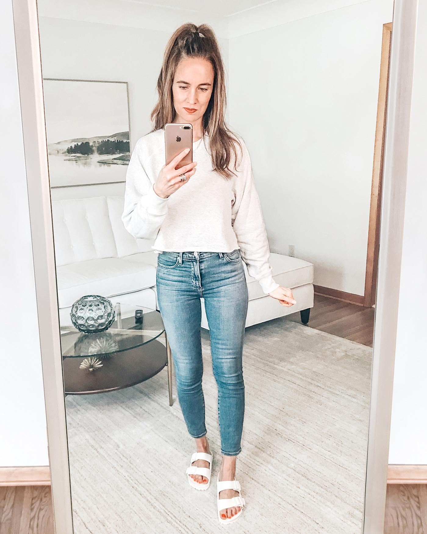 grey crop sweatshirt, skinny jeans, birkenstock white sandals