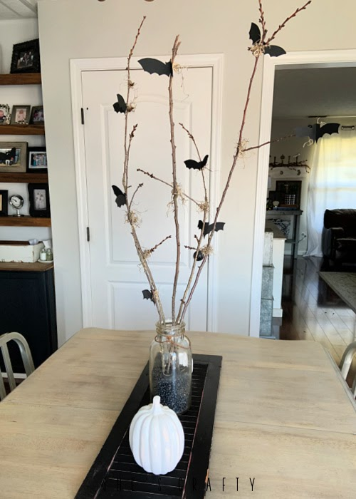 Halloween bat and branch table centerpiece -  bats and branches on a vintage shutter