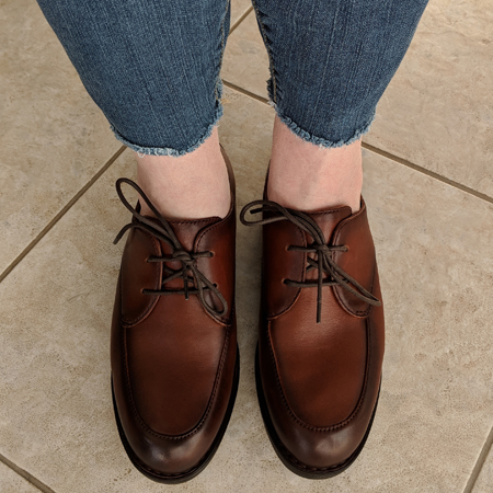 image of my feet clad in cognac leather oxfords