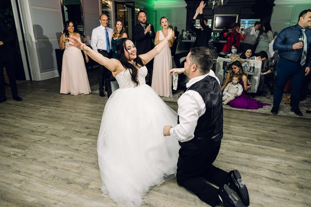 groom and bride during garter removal